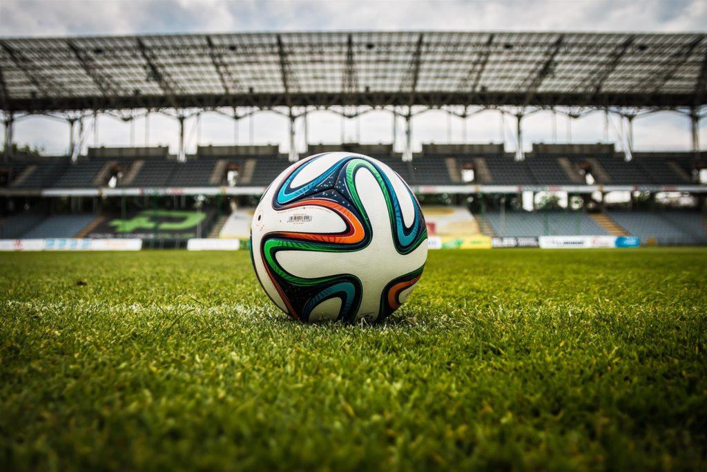 Football On Grass In Stadium