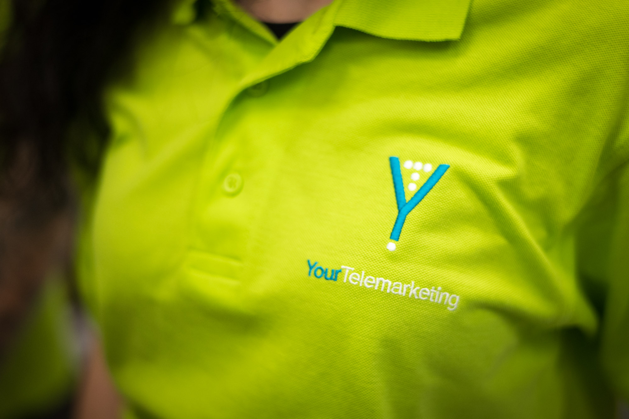 Your Telemarketing Logo On A Green Polo Shirt